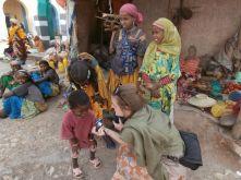 Alyssa Chatting with Children