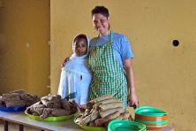Food Manager and Assistant with Heaps of Injera